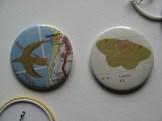 Assorted badges; maps, birds and butterflies; © Jo Aylward & Podpress