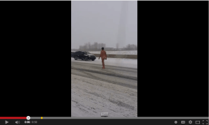 Guy walking naked in a snow storm up I-75