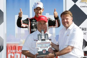 1 June, 2014, Detroit, Michigan, USA Roger Penske receives his trophy from Jim Campbell and is photobombed by Helio Castroneves ©2014, Michael L. Levitt LAT Photo USA