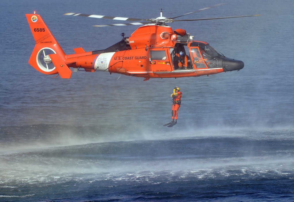 Coast Guard Dolphin with swimmer