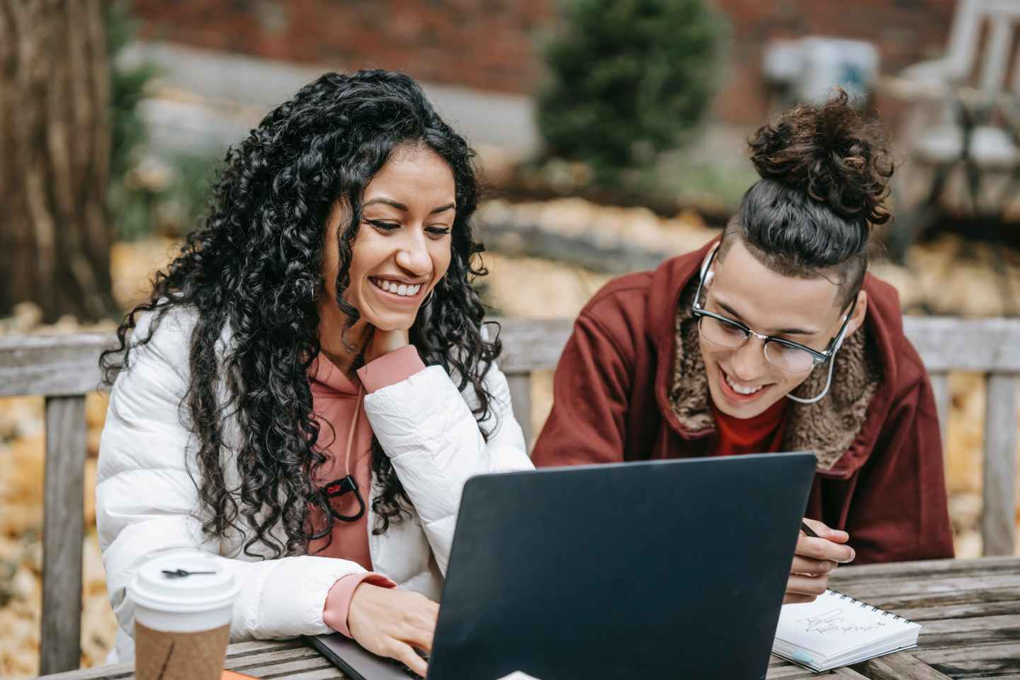 young diverse positive students surfing internet on laptop