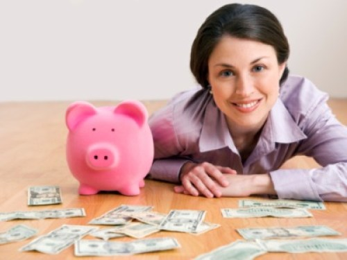 Tips for saving money - mom with piggy bank