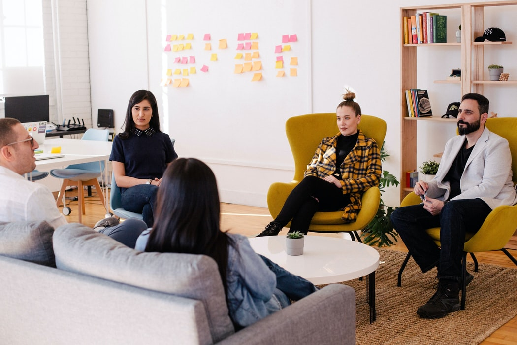 A creative team meeting. Maybe each team member started in a different industry?