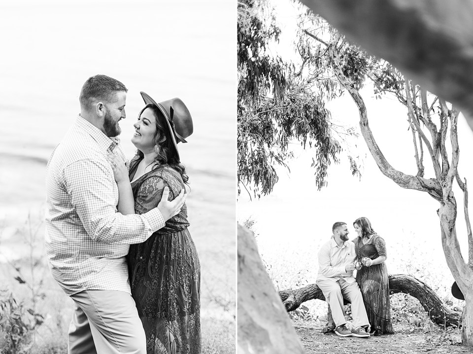 Black and white photos of the couple holding each other close next to the ocean and the couple clinking glasses together while sitting on a fallen branch