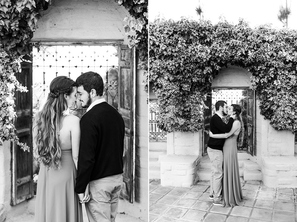 Black and white photos of the couple sharing a moment forehead to forehead in front of a window with the sunlight peeking through. A second photo of the couple sharing a light kiss in front of the same window.