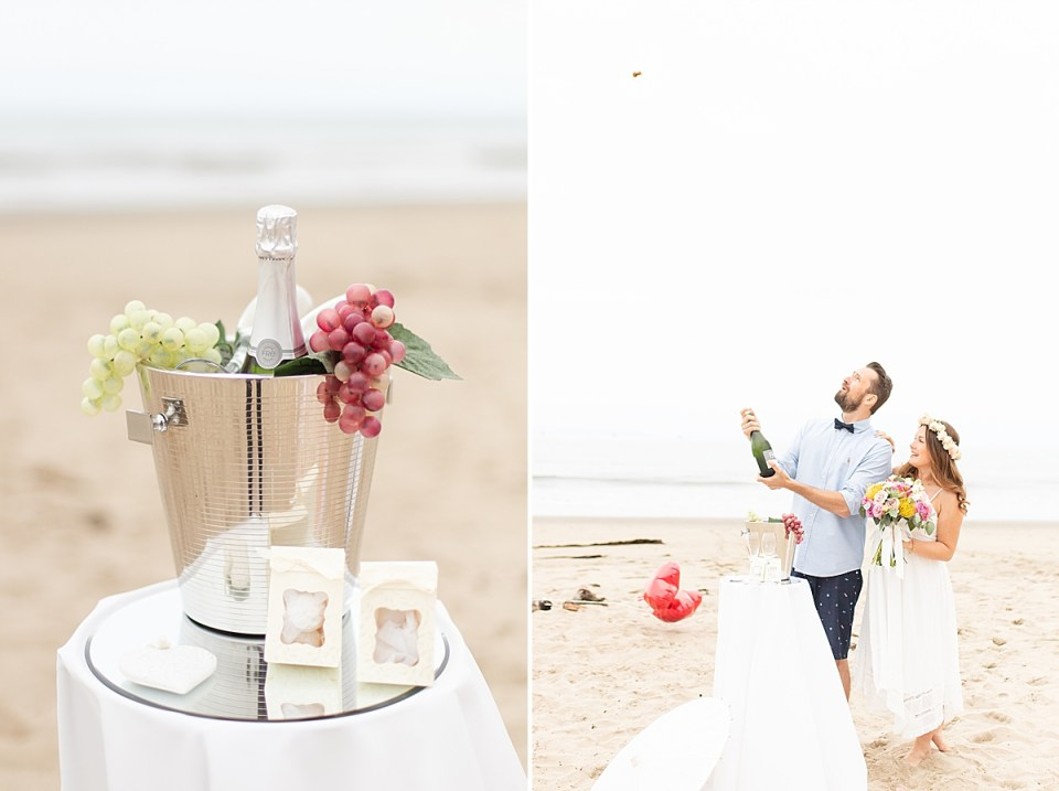 The couple popping their bottle of non-alcoholic champagne and holding onto each other.