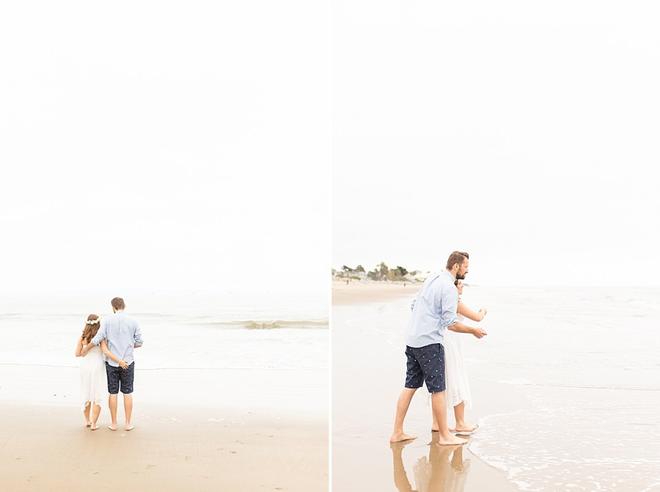 The couple holding hands as they walked out to the waves to throw in a sand dollar. A photo of them throwing the sand dollars.