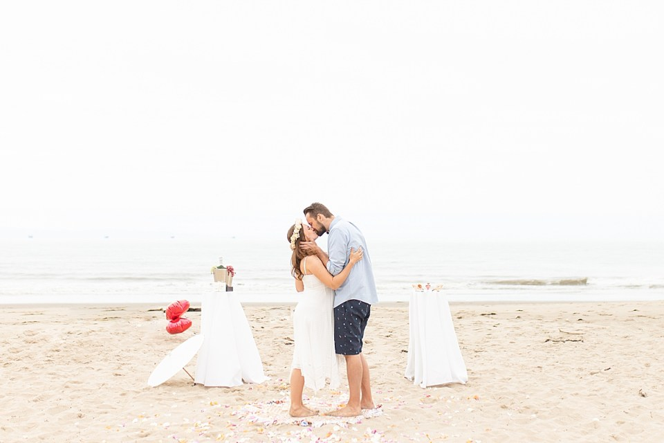 The bride and groom becoming husband and wife during their ceremony while at their Santa Claus Beach Elopement