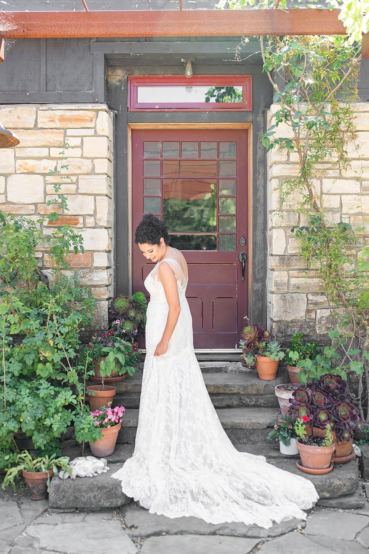 Brandi standing in front of her Rancho San Julian Wedding getting ready room.