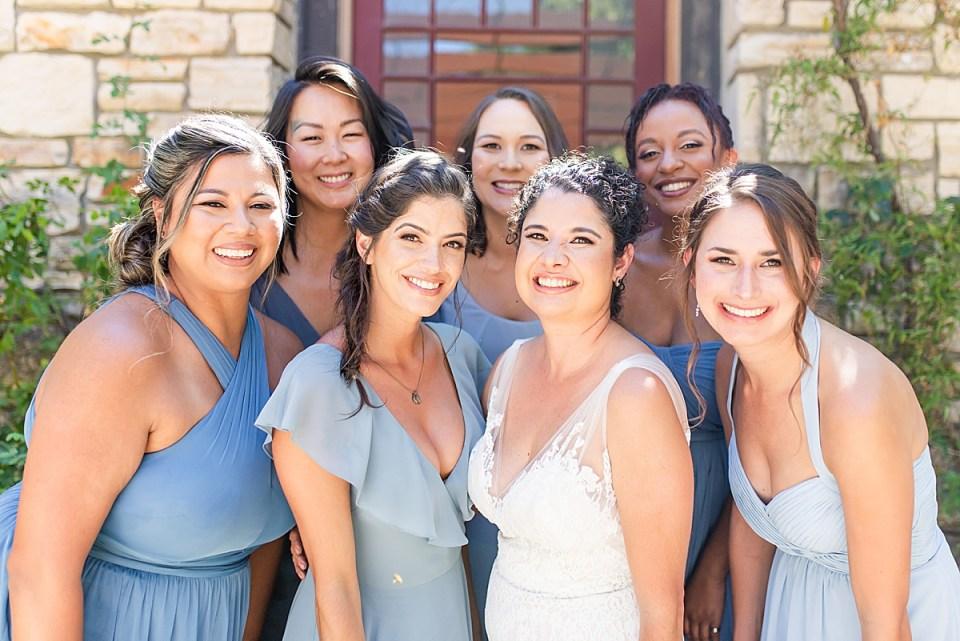 Brandi & her bridesmaids smiling at the camera during her Rancho San Julian Wedding