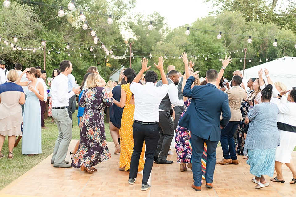 The couples family and friends dancing at the newlyweds Rancho San Julian wedding