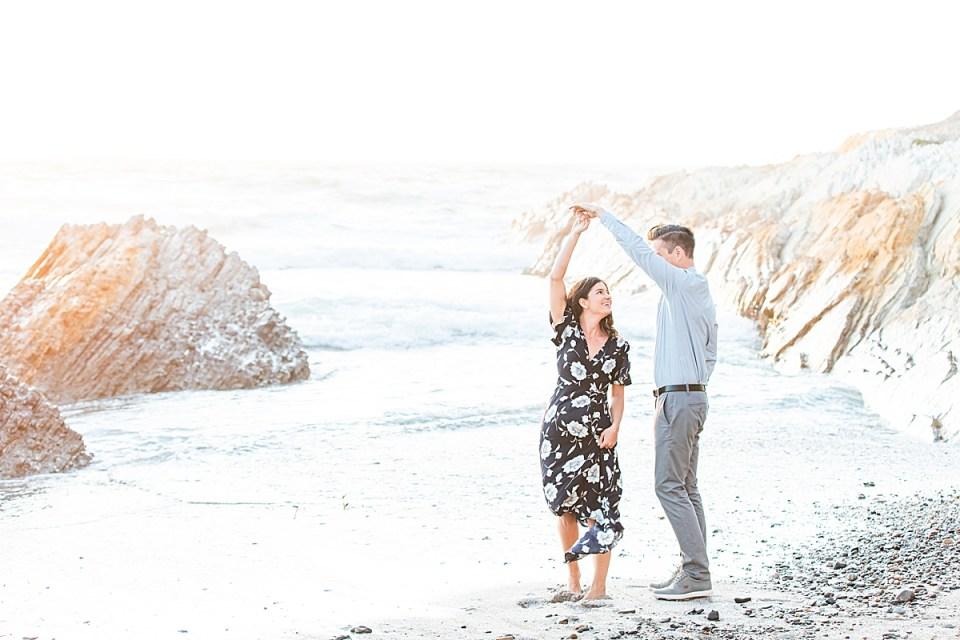 Scott twirls Lauren near the water
