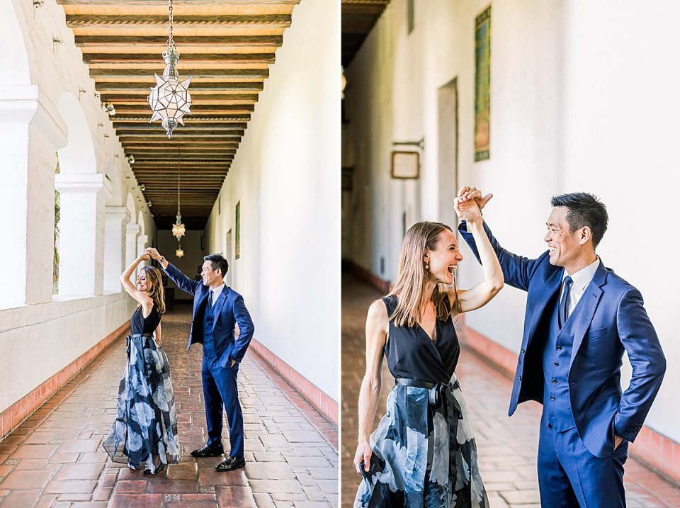 Gideon twirling his bride in the middle of the Santa Barbara Courthouse hallway under the chandlers. A second image of the couple giggling at each there while Erica is twirling.