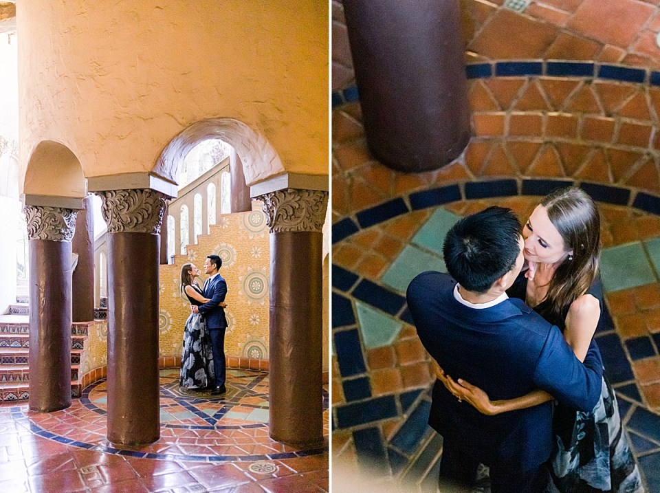 The couple standing on the seal dedicated to the Courthouse surrounded by a spiral staircase.