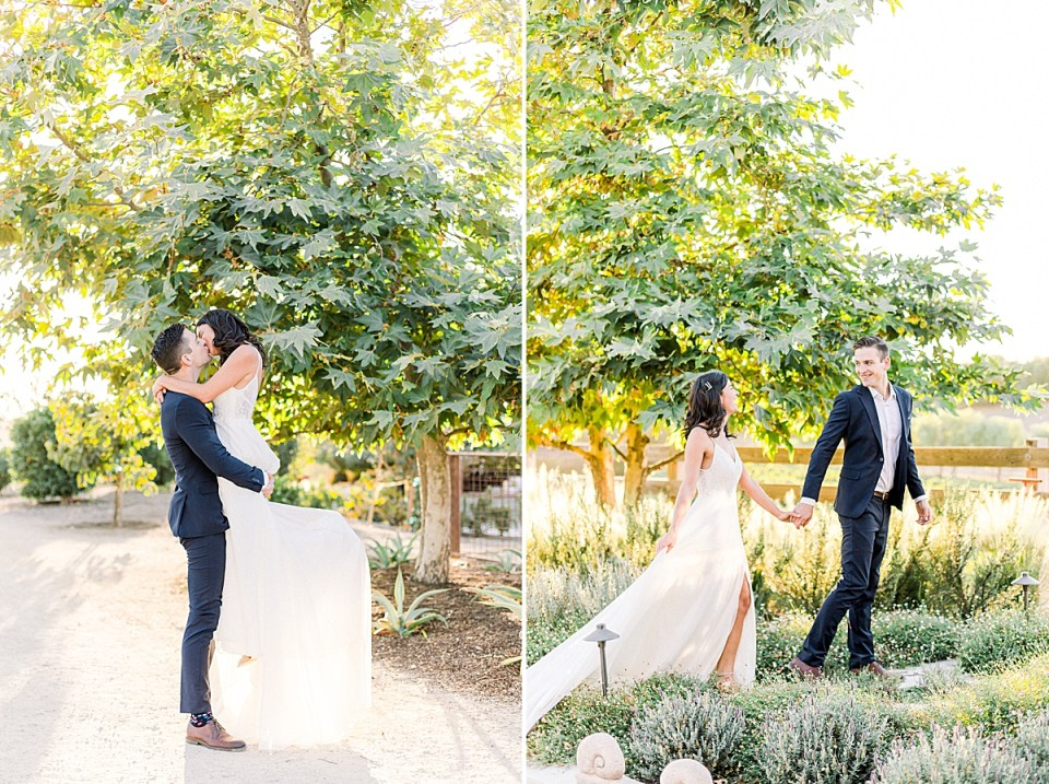 Scott lifting his bride in the air as they share a kiss. A second image of Scott leading his wife through the gardens underneath large trees and surrounded by tall grass during their San Luis Obispo Farm Wedding