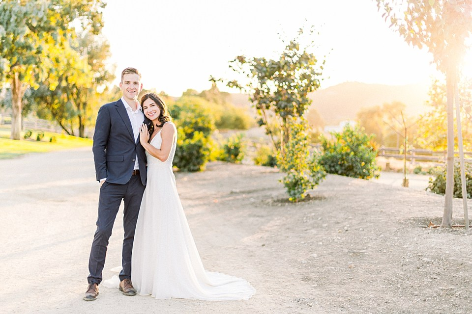 The newlyweds smiling at the camera as Lauren leans her head on Scotts chest.