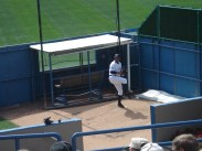 A Yankee reliever warming up in the bullpen.