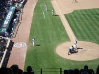A closeup of in-game action at Wrigley Field.