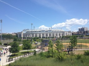 A view from outside of the stadium. You can see part of Heritage Field and also the walkway containing the historic moments in Yankee history