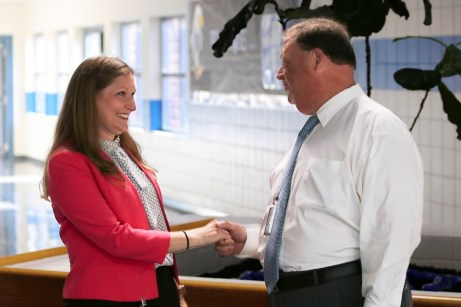 Clayton Middle Principal Catherine Trudell (left) greets JCPS Superintendent Dr. Ross Renfrow (right) on the first day of school.