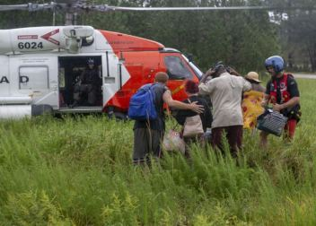 An MH-60T Jayhawk Helicopter crew from Coast Guard Air Station Elizabeth City, North Carolina, evacuates residents from Rocky Point, North Carolina due to flooding caused by Hurricane Florence. A total of 26 adults, 11 children, seven dogs and four cats were evacuated from the neighborhood. U.S. Coast Guard photo by Petty Officer 2nd Class Dustin Williams