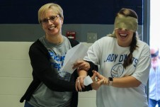Clayton High School teachers Ann Meigs (left) and Rachel Camarota (right) participate in a professional development exercise during the school's Flex Day on Friday.