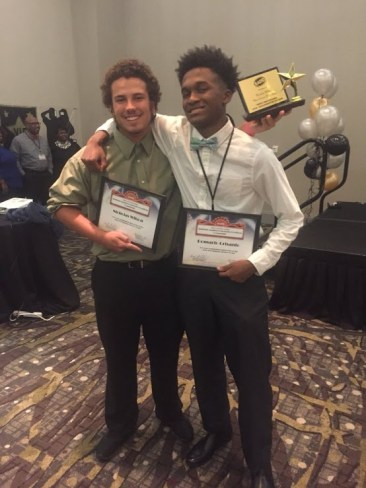 West Johnston High SADD Club members Nicholas Wilson (left) and Romario Crisanto (right) proudly display their awards.