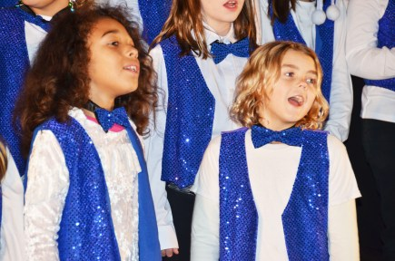 Prior to the tree lighting and parade during Friday night's Benson Christmas on Main, the Benson Elementary School Choir took to the stage to sing holiday tunes. Showing off their talent were Trinity Farthingham and Madisun Cook.