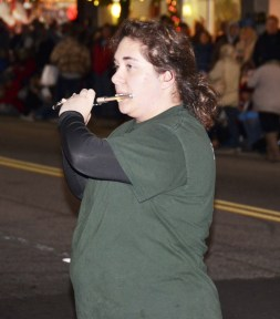 South Johnston High School flutist Rachel Peterson shows her skills during a performance of the Marching Trojans during Benson's Christmas Parade Friday night. The march down Main Street was the final portion of the Christmas on Main Celebration.