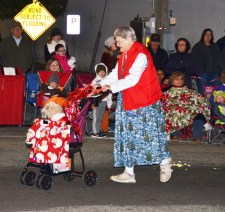 "A crowd favorite is downtown Benson regular ""Miss Joyce"" Washburn and her friend Susie Q the poodle. They were a part of the annual Benson Christmas Parade which took place Friday night during the Christmas on Main celebration in the Johnston County town."
