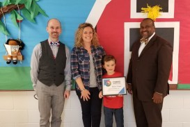 Dixon Road Elementary student Mason Tingen is presented with a $500 Student Innovator grant for drones to simulate how bees pollinate flowers. Photographed (from left) are Executive Director of Educator Innovation Jamie Lanier, Dixon Road Elementary teacher Jackie Tingen, Mason Tingen, and Dixon Road Elementary Principal Kenneth Bennett.