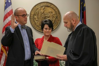 Todd Sutton (left) was sworn in to the Johnston County Board of Education on Friday, Dec. 7 at the Johnston County Courthouse by Senior Resident Superior Court Judge Thomas Lock (right). Accompanying Sutton at the swearing in is his wife, Lynda (center).