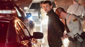 Officers take Justin Lynn Chapman of Sanford into custody following an extensive manhunt Friday night near Benson. Photo by John Payne
