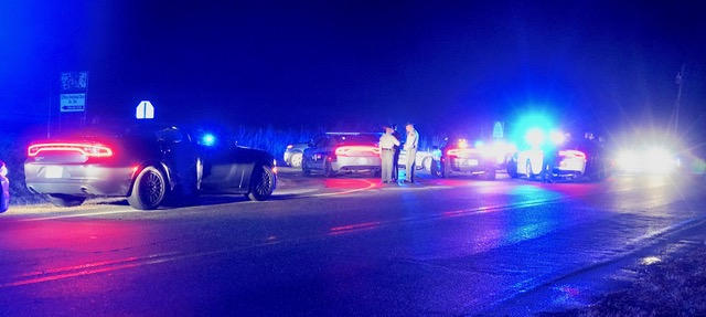 Multiple law enforcement officers from several counties responded to a chase and shooting near Benson Friday night. Photo by John Payne