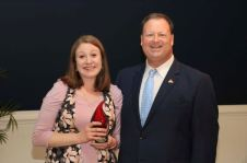 Abby Stephenson (left), School Counselor at Pine Level Elementary, was selected as the Employee of the Year for her field. Standing with her is JCPS Superintendent Dr. Ross Renfrow (right).