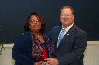 Vicky Montgomery (left), Program Specialist, was selected as the School Support Personnel Employee of the Year. Standing with her is JCPS Superintendent Dr. Ross Renfrow (right).