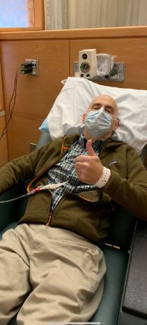 Lillington dentist Dr. David Price gives a thumbs up signal from his hospital bed at UNC Hospitals in Chapel Hill. He is being treated there for leukemia and local residents are trying to find a match for a bone marrow transplant.
