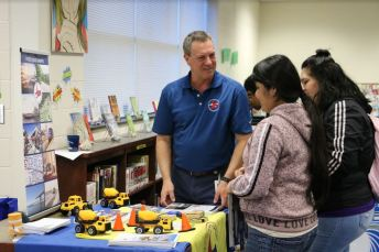 Barry Bridges (left), NC Department of Transportation Supervisor of the Talent Management Team, talks with Cleveland High students Angela Pena (center) and Angel Hernandez about opportunities with the NCDOT at Make a Plan Day.