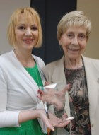 Leigh Ross, clinical chaplain and volunteer coordinator at Johnston Health Clayton, presents the Sue Archambeault Award for exemplary volunteerism to B. J. Christensen.