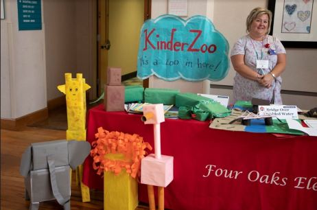 Four Oaks Elementary teacher Courtney Andrews displays her students' work with the project KinderZoo.