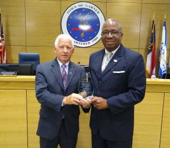 Elmo Vance with Council Member Marshburn during recognition at the July 1 Town Council meeting.
