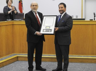 Outgoing Councilman Emery Ashley received a plaque and honorary Key to the City from Mayor Andy Moore. Ashley served two terms on the Smithfield Town Council but did not seek re-election this year.