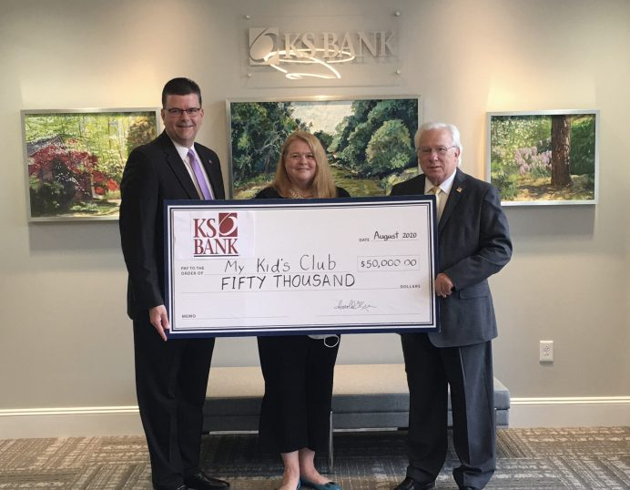 Pictured with MKC Executive Director Alison Gammage (center) is Harold T. Keen, KS Bank President/CEO (right) and Earl W. Worley Jr., KS Bank Chief Operating Officer (left).