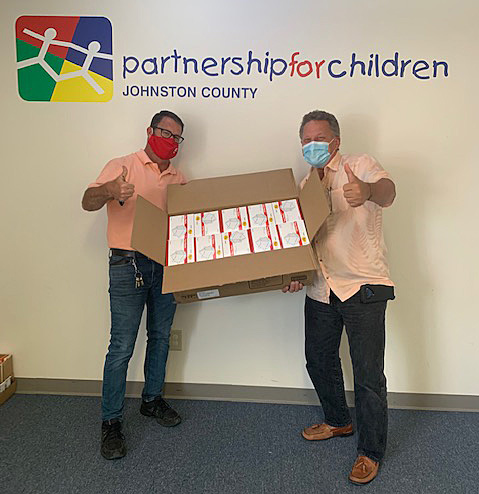 (Left to right) Rob Diamato of Lowes Home Improvement and PFCJC Executive Director Dwight Morris with 500 masks.