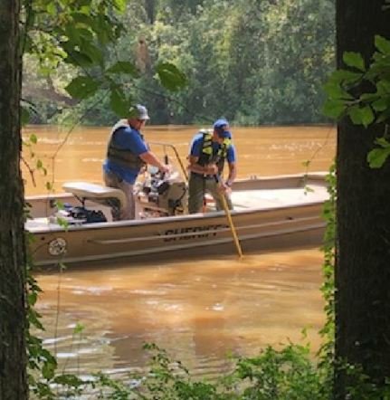 The Johnston County Sheriff's Office searches a section of the Neuse River in Smithfield Wednesday afternoon.