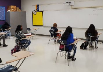Brogden Middle school students social distance in a classroom on September 8, 2020.