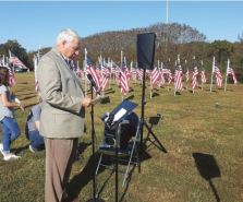 Harnett County Sheriff Wayne Coats offers remarks at Saturday's dedication for the Flags for Heroes site outside Angier. His deputies are among those honored by the flags. Dunn Daily Record Photo