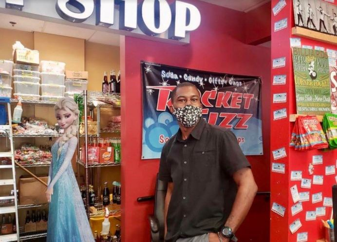 Cyrus Glass, owner of Rocket Fizz Soda Pop & Candy Shop near Fayetteville Street in Raleigh, is prepared to defend his store if needed. CJ photo by Lindsay Marchello