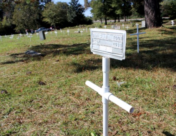 The grave of James Toon, a former coach at Fayetteville University, is marked with a cross at Wilkins Cemetery. Dunn Daily Record Photo