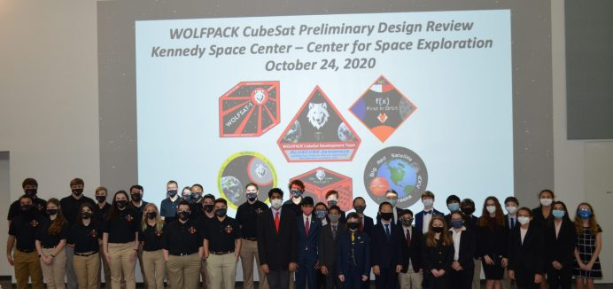 Eighteen students from N.C.'s f(x) First in Orbit CubeSat team traveled to Kennedy Space Center to meet veteran members of Florida's Wolfpack CubeSat team. Both teams, along with a rookie team from Nebraska, presented initial payload ideas as they prepare their proposal design review for submission to NASA in mid-December.Photo by Dunja Nascimento-Wilson
